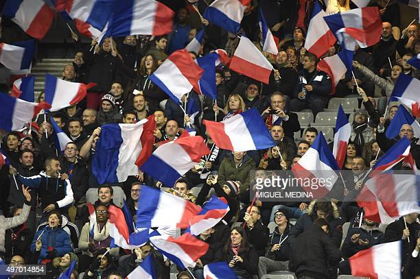 France's supporters cheer prior to a friendly international football match between France and Germany ahead of the Euro 2016 on November 13 2015 at...