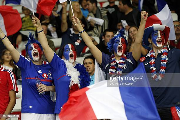France's supporters cheer their team during the friendly football match between France and Armenia on October 8 2015 at the Allianz Riviera stadium...