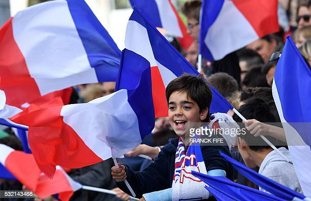 France's supporters wave French national flags during a training session at the Aguilera stadium in Biarritz as part of the team's preparation for...