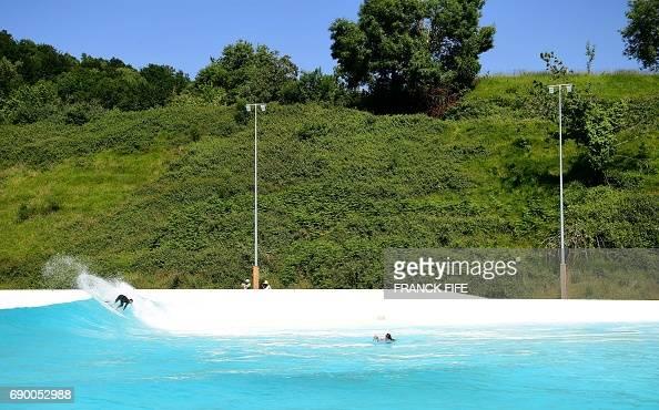 Topshot france 39 s surfer joan duru trains at wave garden for Garden training pool