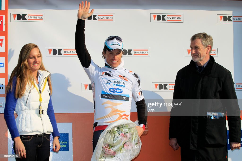 France's Sylvain Chavanel (C) of team Omega Pharma - Quick Step celebrates on the podium after winning the second part of the third and last stage of the Driedaagse De Panne - Koksijde cycling race, 14.75 km individual time trial in De Panne, on March 28, 2013.