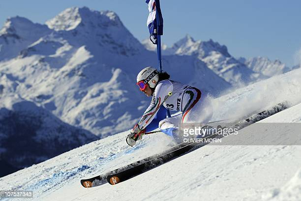 France's Taina Barioz clears a gate during the first run of the alpine skiing World Cup giant slalom race on December 12 2010 in St Moritz AFP PHOTO...