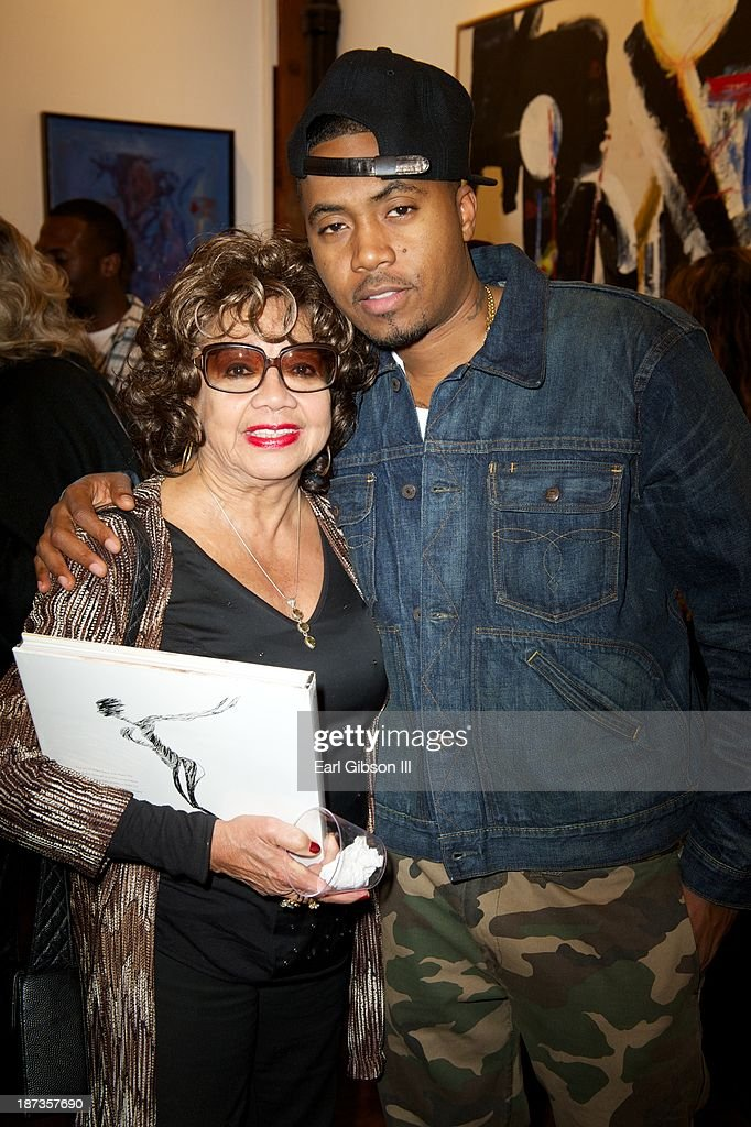Frances Taylor and Rapper <a gi-track='captionPersonalityLinkClicked' href=/galleries/search?phrase=Nas&family=editorial&specificpeople=204627 ng-click='$event.stopPropagation()'>Nas</a> attend the 'Miles Davis: The Collected Artwork' Launch Party at Mr. Musichead Gallery on November 7, 2013 in Los Angeles, California.