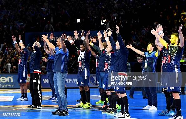 TOPSHOT France's team and coach acknowledge the public after France won the 25th IHF Men's World Championship 2017 semifinal handball match France vs...