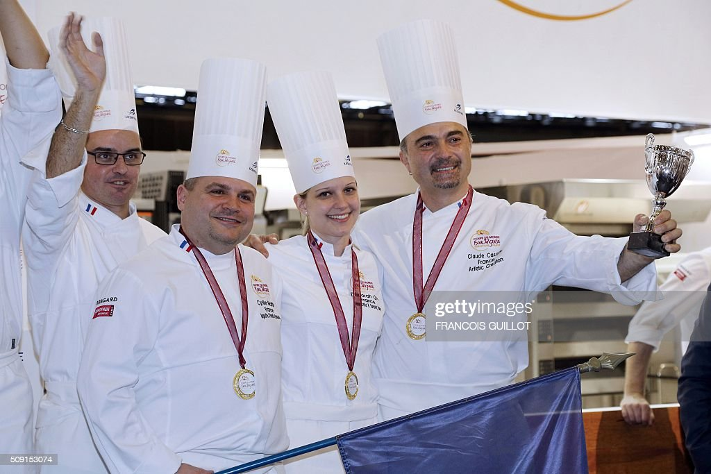 France's team celebrate with their trophy after winning the third place during the Bakery world cup, as part of the Europain fair, on February 9, 2016, in Villepinte near Paris. / AFP / FRANCOIS GUILLOT