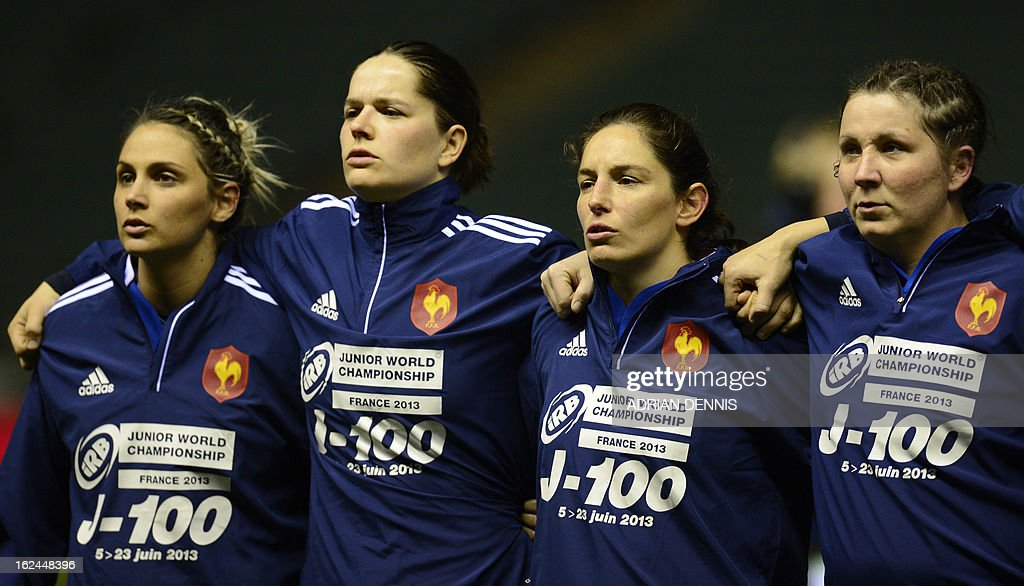 France's team line up wearing a jacket promoting the Rugby Junior World Championship before the start of the Six Nations women's international rugby union match between England and France at Twickenham Stadium in south-west London on February 23, 2013.