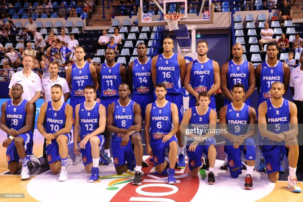 France's team lines up before the friendly basketball match France vs Croatia on August 8 2014 in Pau southwestern France as part of the preparation...