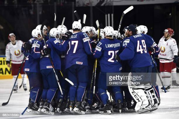 France's team players celebrate after winning the IIHF Men's world Championship group B ice hockey match between France and Belarus in Paris on 12...