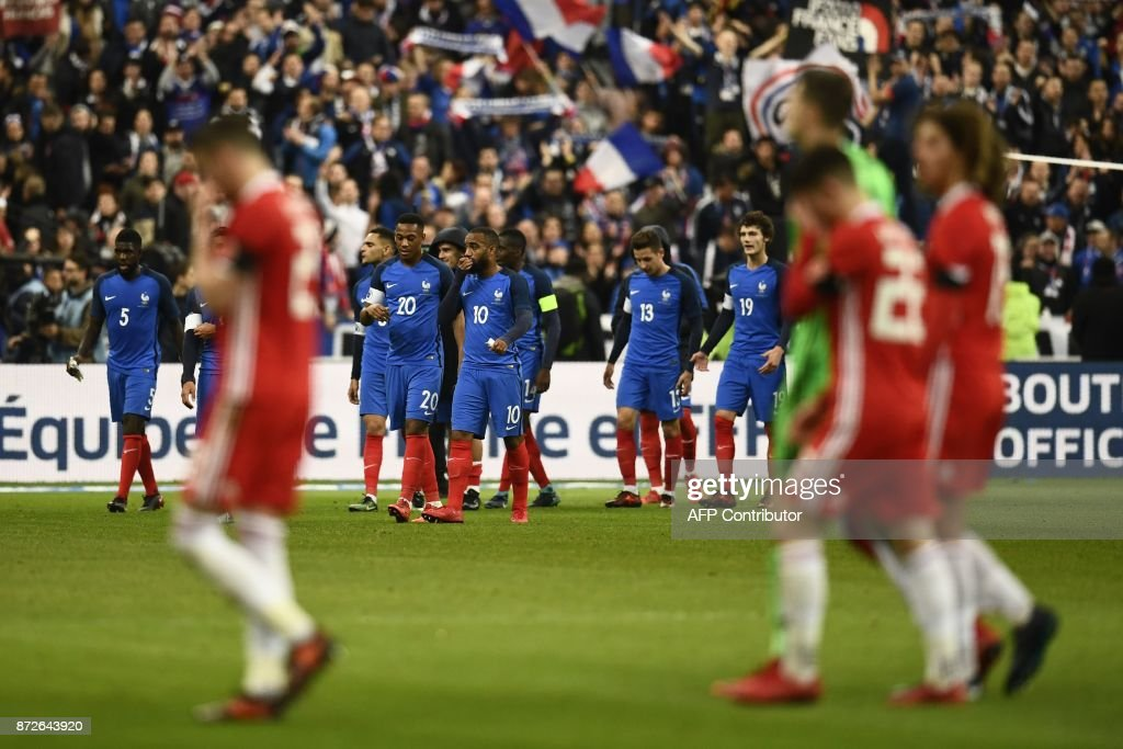 France's team players celebrates after winning at the end of the friendly football match between France and Wales at the Stade de France stadium, in Saint-Denis, on the outskirts of Paris, on November 10, 2017. /