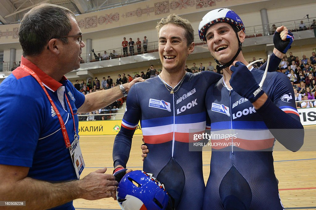 France's team Vivien Brisse (2nd L) and Morgan Kneisky (R) celebrate with a coach after winning the gold in the UCI Track Cycling World Championships Men's 50 km Madison in Belarus' capital of Minsk on February 24, 2013. AFP PHOTO/KIRILL KUDRYAVTSEV