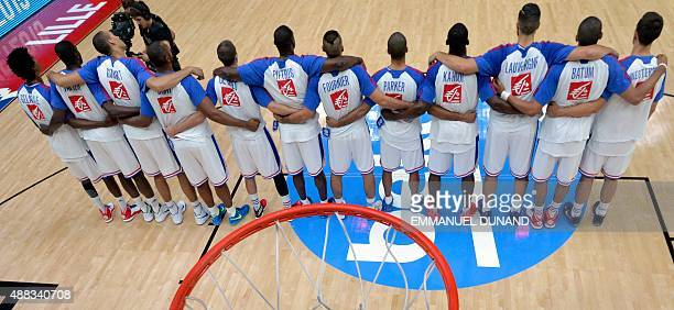 France's teammates gather for the national anthem prior to the round of 8 basketball match between France and Latvia at the EuroBasket 2015 in Lille...