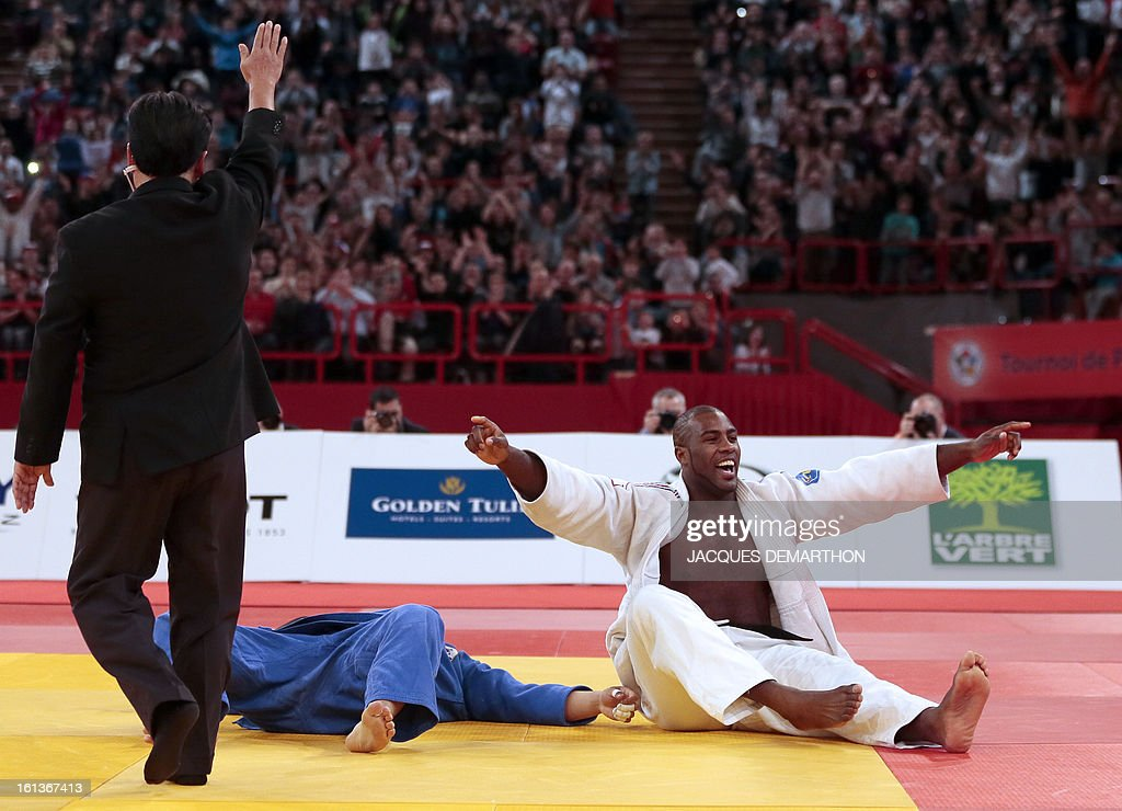 France's Teddy Riner (R) celebrates after beating South Korea's Kim Sung-Min on February 10, 2013, during the Men +100kg final of the Paris International Judo tournament, part of the Grand Slam, at the Palais Omnisports de Paris-Bercy (POPB) in Paris.