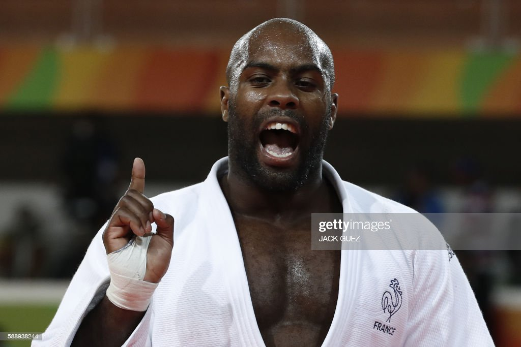 TOPSHOT France's Teddy Riner celebrates after defeating Japan's Hisayoshi Harasawa during their men's 100kg judo contest gold medal match of the Rio...