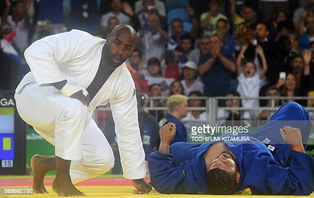 TOPSHOT France's Teddy Riner competes with Algeria's Mohammed Amine Tayeb during their men's 100kg judo contest match of the Rio 2016 Olympic Games...