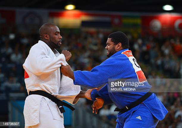 France's Teddy Riner competes with Cuba's Oscar Brayson during their men's 100kg judo contest quarter final match of the London 2012 Olympic Games on...