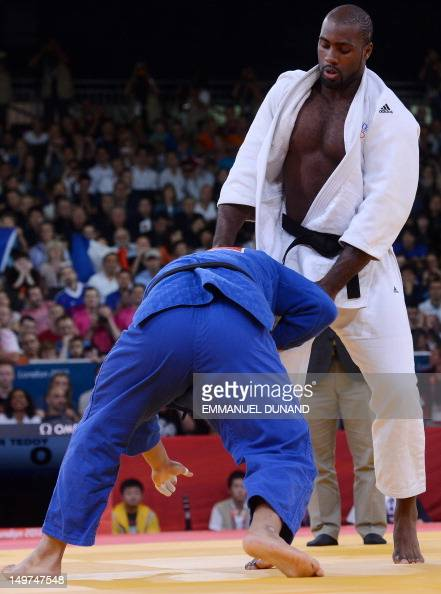 France's Teddy Riner competes with Korea's Kim SungMin during their men's 100kg judo contest semifinal match of the London 2012 Olympic Games on...
