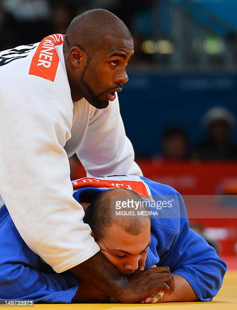 France's Teddy Riner competes with Tunisia's Faicel Jaballah during their men's 100kg judo contest match of the London 2012 Olympic Games on August 3...