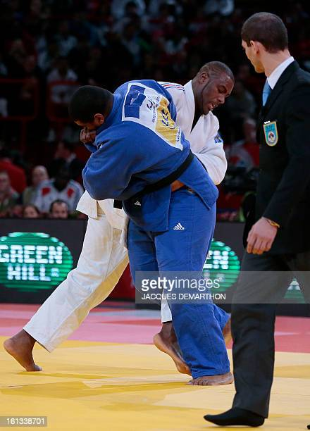 France's Teddy Riner fights against Cuba's Oscar Brayson on February 10 2013 in Paris during the semifinals of the Men 100kg of the Paris Judo Grand...