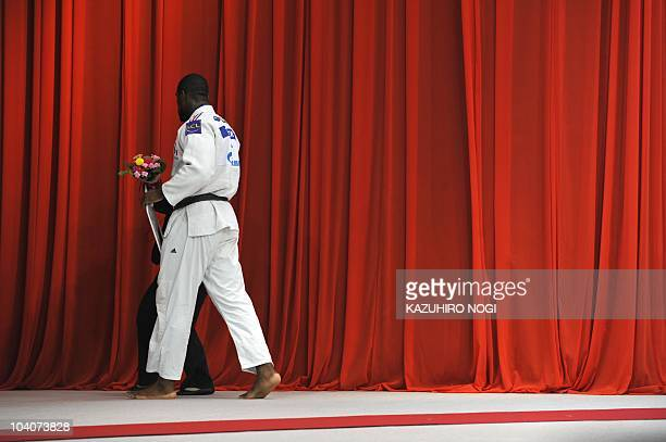France's Teddy Riner leaves from the awarding ceremony of the men's open category competition at the 2010 World Judo Championships in Tokyo on...