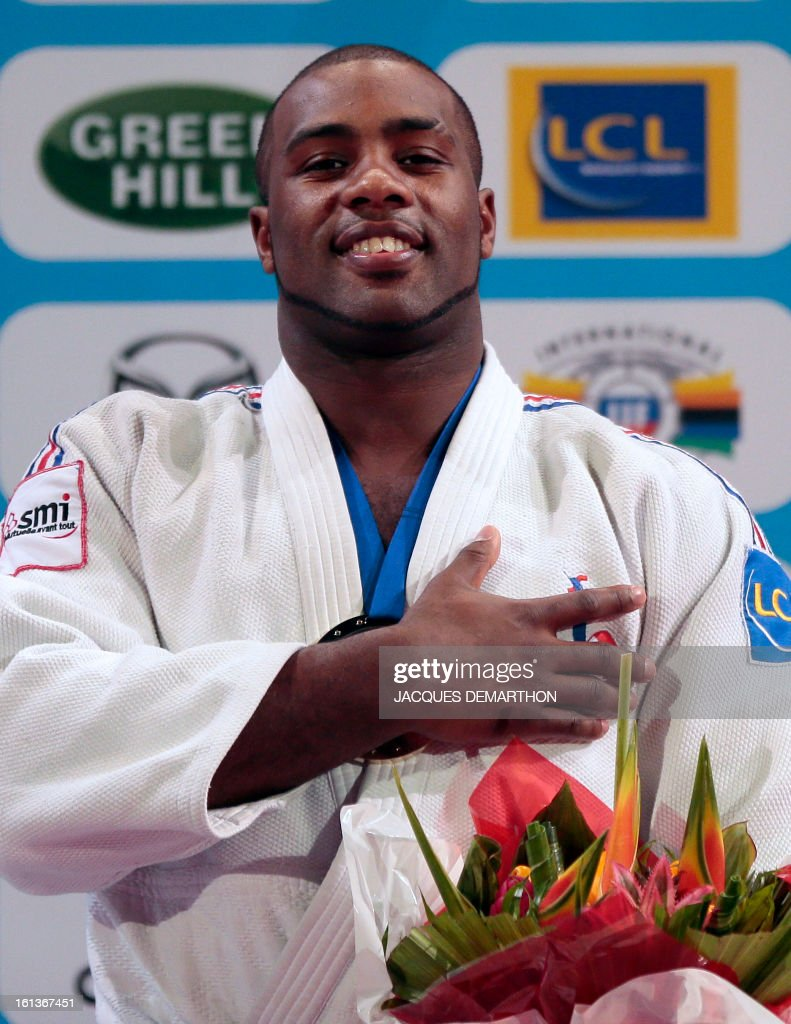 France's Teddy Riner listens to French national anthem on the podium after beating South Korea's Kim Sung-Min on February 10, 2013, during the Men +100kg final of the Paris International Judo tournament, part of the Grand Slam, at the Palais Omnisports de Paris-Bercy (POPB) in Paris.