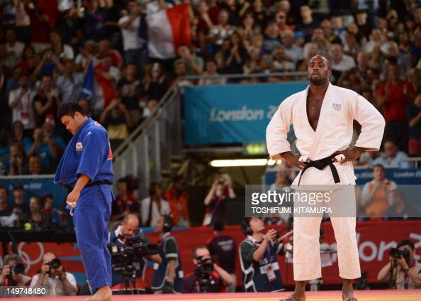 France's Teddy Riner reacts after winning against Korea's Kim SungMin during their men's 100kg judo contest semifinal match of the London 2012...