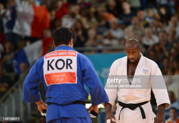 France's Teddy Riner salutes Korea's Kim SungMin after winning their men's 100kg judo contest semifinal match of the London 2012 Olympic Games on...