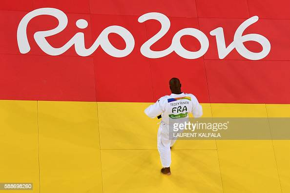 TOPSHOT France's Teddy Riner walks on the tatami as he competes with Israel's Or Sasson during their men's 100kg judo contest semifinal A match of...
