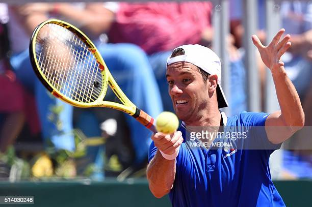 France's tennis player Richard Gasquet returns the ball to Canada's tennis player Philip Bester during the Davis Cup World Group firstround between...