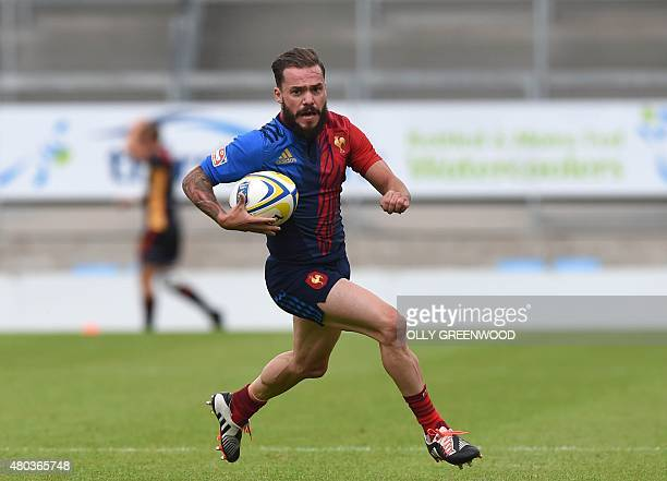 France's Terry Bouhraoua runs at the Portugal defence during the European Rugby Sevens Grand Prix Series rugby union tournament at Sandy Park Exeter...