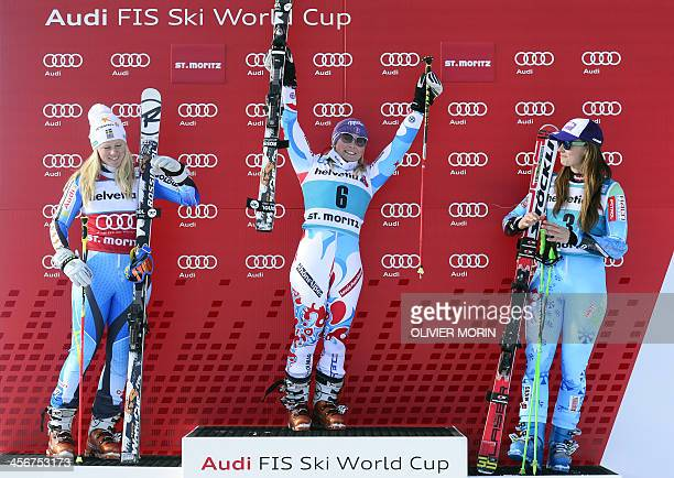 France's Tessa Worley celebrates on the podium after winning the FIS Alpine World Cup Women's Giant Slalom with secondplaced Sweden's Jessica...