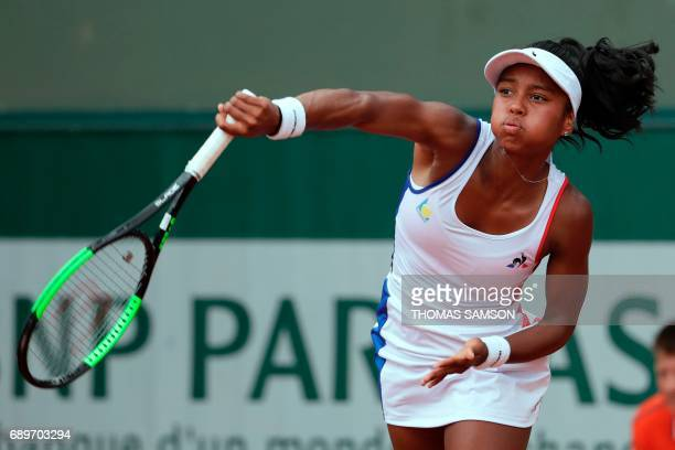 France's Tessah Andrianjafitrimo returns the ball to Canada's Francoise Abanda during their tennis match at the Roland Garros 2017 French Open on May...