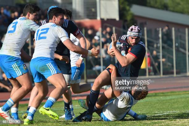France's Theo Millet is tackled by Italy's Charly Trussardi during the Under 20 Six Nations rugby union match between Italy and France at the Santa...