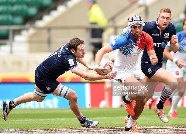 France's Theo Millet is tackled by Scotland's Scott Riddell during the pool C match of the World Rugby Sevens Series London rugby union tournament...