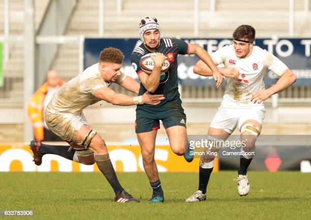 France's Theo Millet under pressure from England's Nick Isiekwe during the Under20s Six Nations Round 1 match between England U20 and France U20 at...