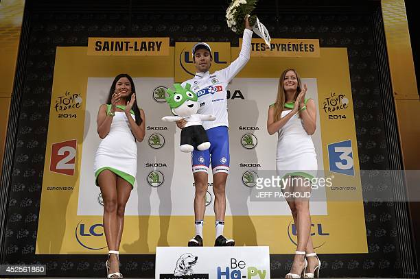 France's Thibaut Pinot celebrates his white jersey of best young on the podium at the end of the 1245 km seventeenth stage of the 101st edition of...