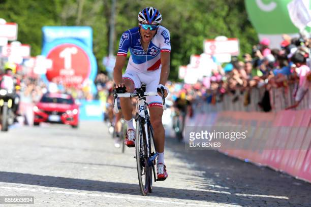 France's Thibaut Pinot of team FDJ 5th crosses the finish line of the 14th stage of the 100th Giro d'Italia Tour of Italy cycling race from...