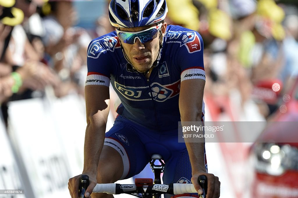 France's <a gi-track='captionPersonalityLinkClicked' href=/galleries/search?phrase=Thibaut+Pinot&family=editorial&specificpeople=6335753 ng-click='$event.stopPropagation()'>Thibaut Pinot</a> reacts as he crosses the finish line at the end of the 197.5 km thirteenth stage of the 101st edition of the Tour de France cycling race on July 18, 2014 between Saint-Etienne and Chamrousse, central eastern France. Italy's Vincenzo Nibali won the stage.