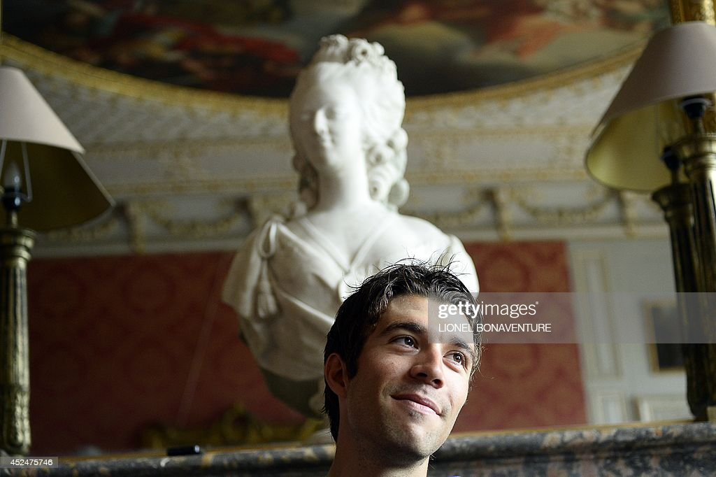 France's <a gi-track='captionPersonalityLinkClicked' href=/galleries/search?phrase=Thibaut+Pinot&family=editorial&specificpeople=6335753 ng-click='$event.stopPropagation()'>Thibaut Pinot</a> smiles as he gives a press conference at his hotel in Pennautier, southern France, during a rest day as part of the 101th edition of the Tour de France cycling race on July 21, 2014.