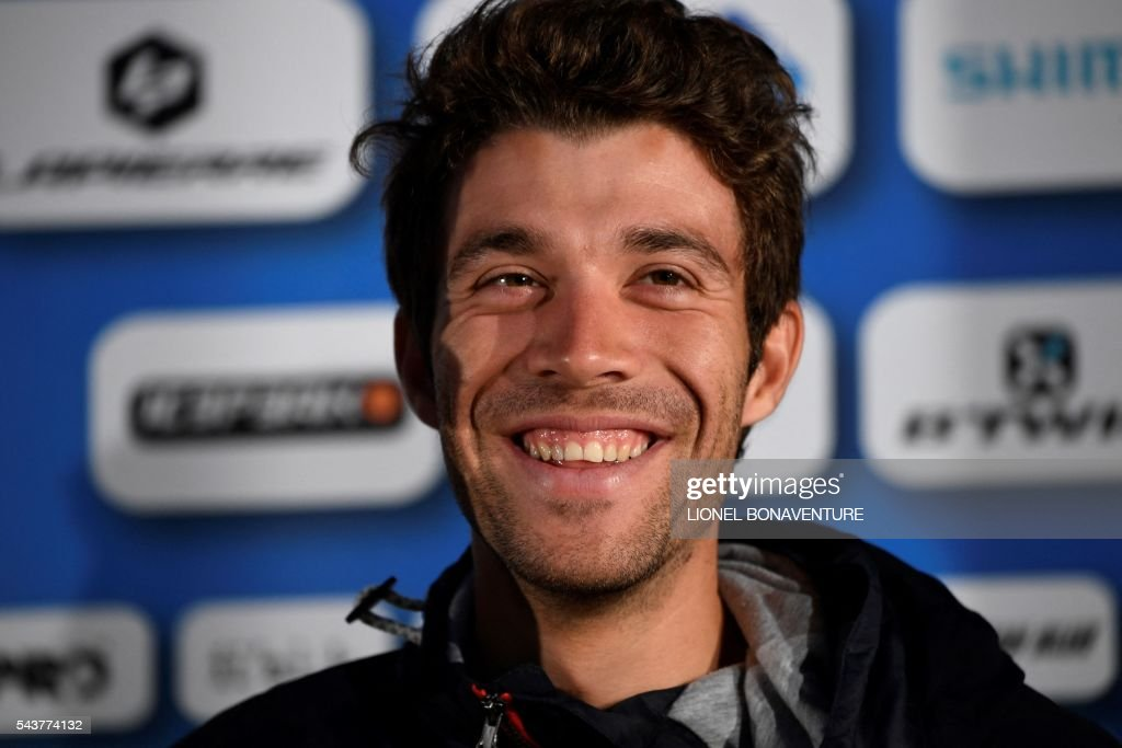 France's Thibaut Pinot smiles as he takes part in a press conference of the France's FDJ cycling team at the press center in Saint-Lo, Normandy, on July 30, 2016, two days before the start of the 103rd edition of the Tour de France cycling race. The 2016 Tour de France will start on July 2 in the streets of Le Mont-Saint-Michel and ends on July 24, 2016 down the Champs-Elysees in Paris. The 2016 Tour de France will start on July 2 in the streets of Le Mont-Saint-Michel and ends on July 24, 2016 down the Champs-Elysees in Paris. / AFP / LIONEL