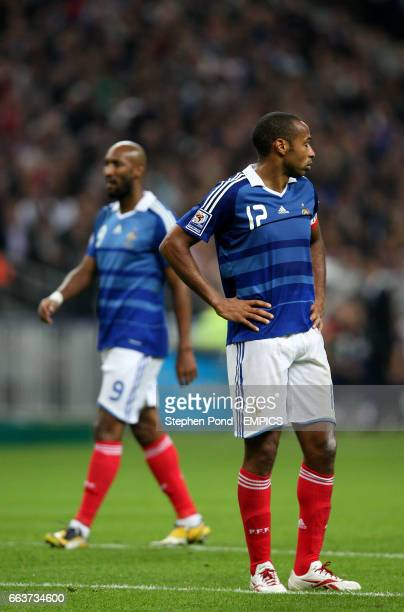 France's Thierry Henry and Nicolas Anelka stand dejected after his second goal is disallowed