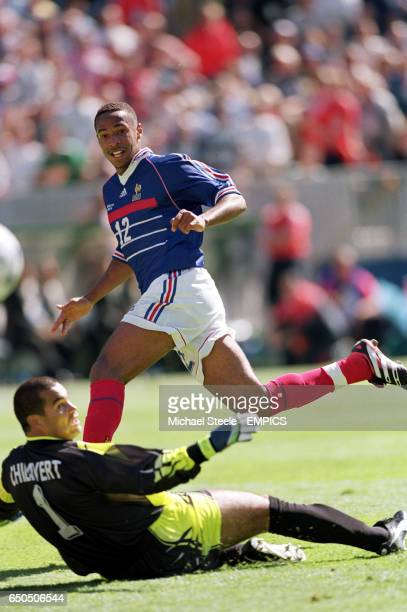 France's Thierry Henry shoots past Paraguay goalkeeper Jose Luis Chilavert