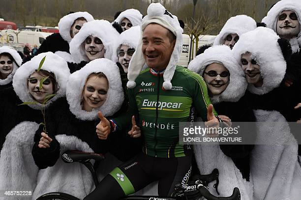 France's Thomas Voeckler poses with people dressed as pandas on March 10 before taking the start of the second stage of the 73rd edition of the...