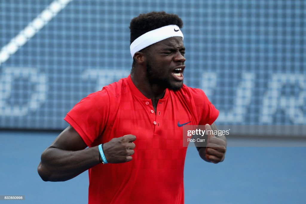 Frances Tiafoe celebrates after defeating Alexander Zverev of Germany during Day 5 of the Western & Southern Open at the Linder Family Tennis Center on August 16, 2017 in Mason, Ohio.
