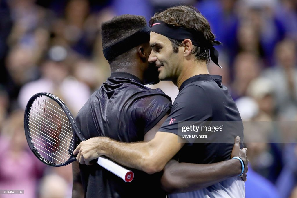 Frances Tiafoe congratulates Roger Federer of Switzerland after their match on Day Two of the 2017 US Open at the USTA Billie Jean King National Tennis Center on August 29, 2017 in the Flushing neighborhood of the Queens borough of New York City.