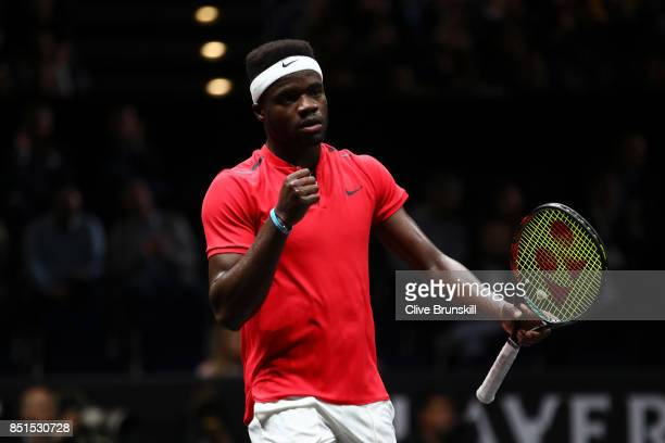 Frances Tiafoe of Team World celebrates winning a point during his singles match against Marin Cilic of Team Europe on the first day of the Laver Cup...