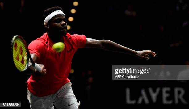 US Frances Tiafoe of Team World returns the ball to Croatian Marin Cilic of Team Europa during first day of Laver Cup on September 22 2017 in O2...