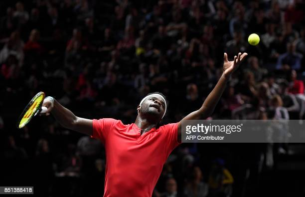 US Frances Tiafoe of Team World serves to Croatian Marin Cilic of Team Europa during first day of Laver Cup on September 22 2017 in O2 Arena in...