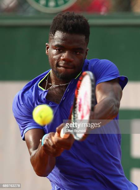 Frances Tiafoe of The United States plays a backhand during the mens singles first round match against Fabio Fognini of Italy on day two of the 2017...