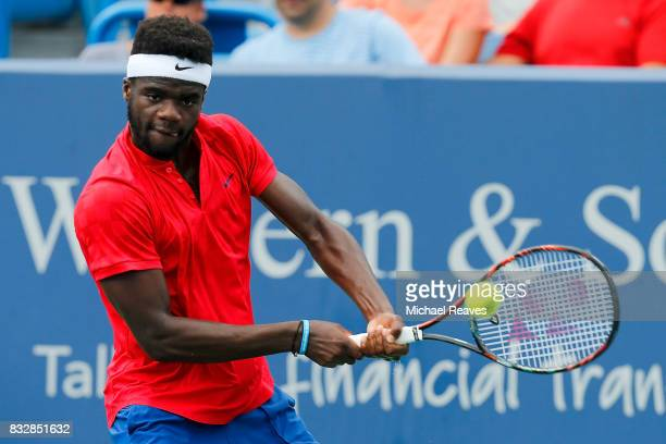 Frances Tiafoe of the United States returns a shot to Alexander Zverev of Germany during Day 5 of the Western and Southern Open at the Lindner Family...
