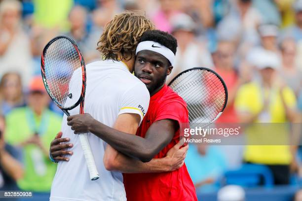 Frances Tiafoe of the United States shakes hands with Alexander Zverev of Germany after defeating him on Day 5 of the Western and Southern Open at...